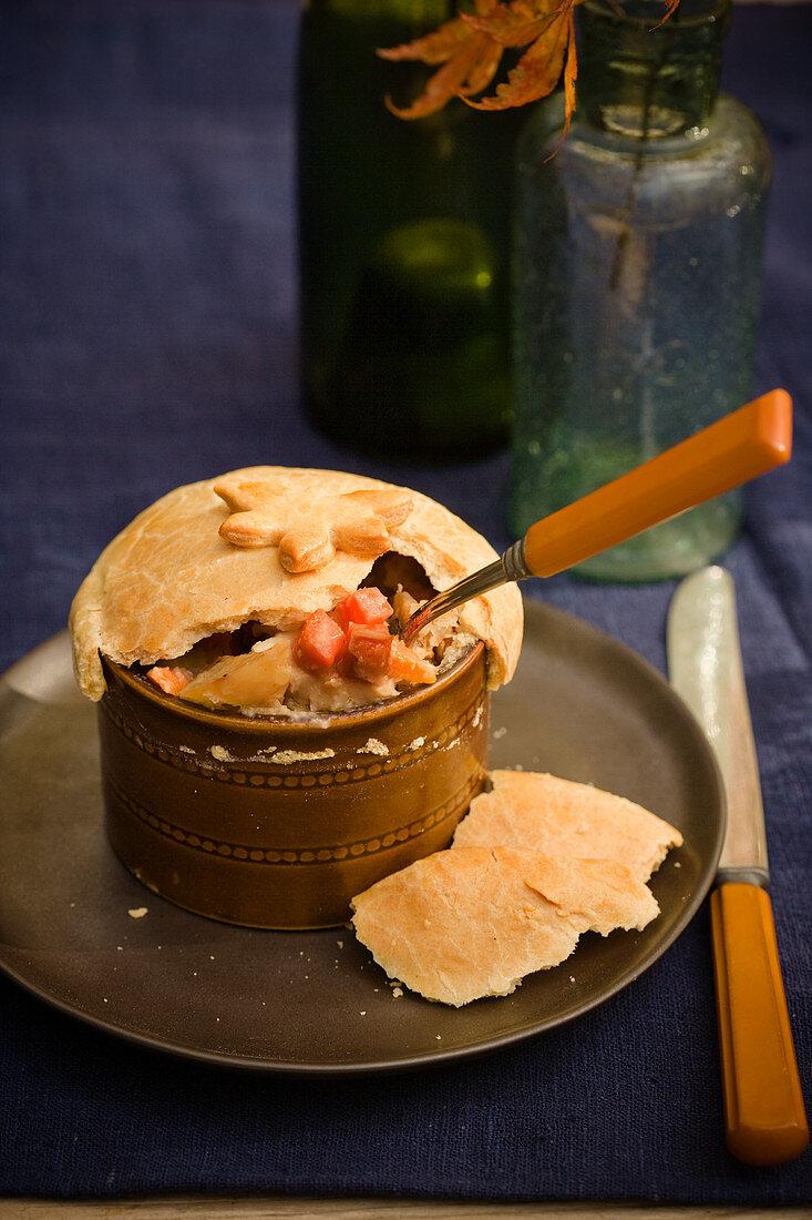 Chicken pot pie with spoon
