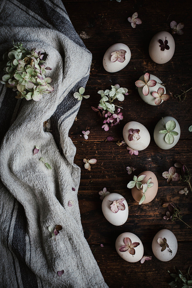 Naturally dyed eggs decorated with flowers (seen from above)