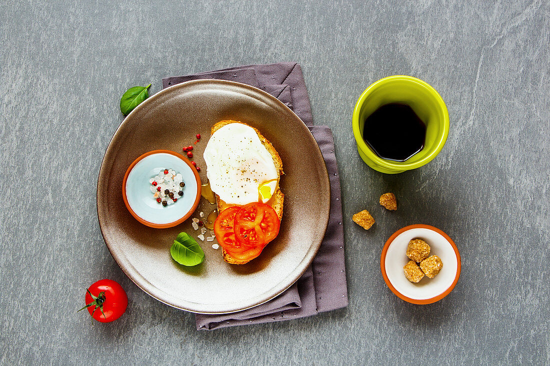 Bruschetta with a poached egg, tomatoes and coffee for breakfast