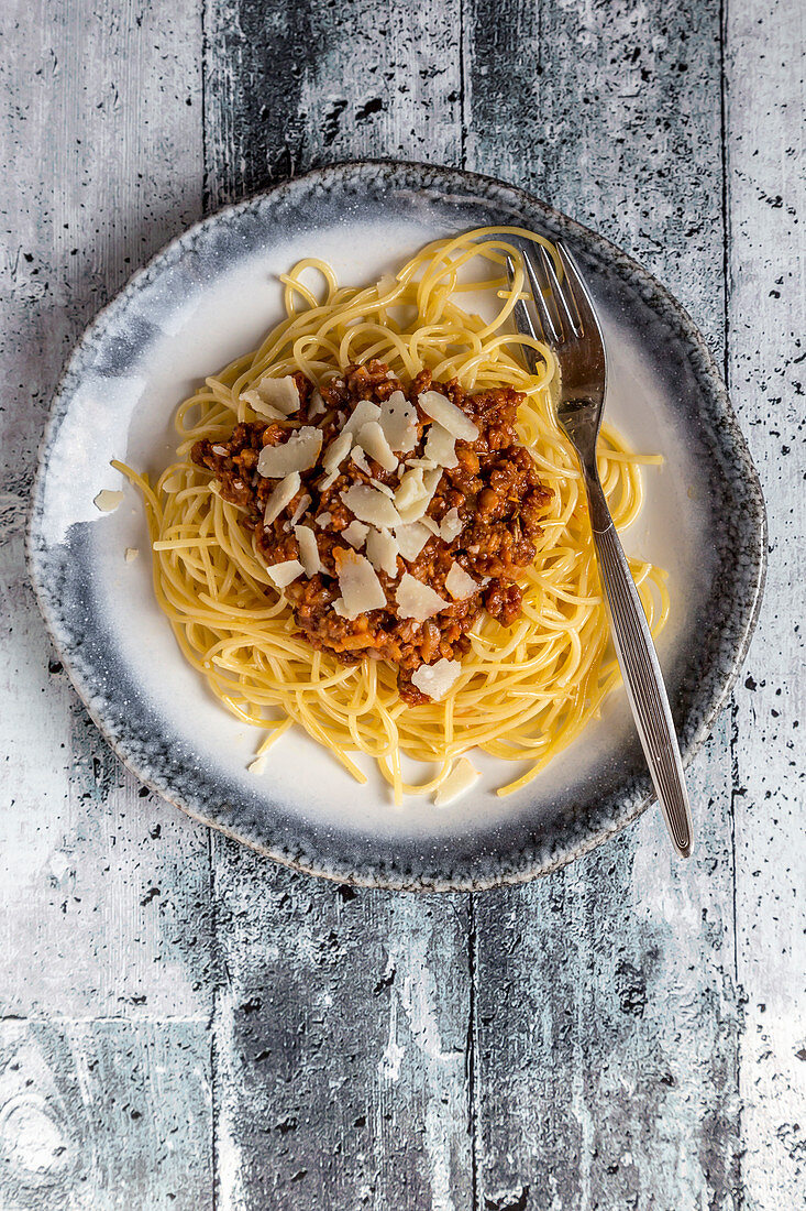 Spaghetti with vegetarian bolognese and shaved Parmesan