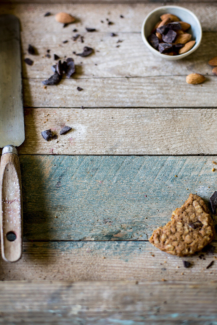 Chocolate chip, almond and oat cookies on rustic wooden surface