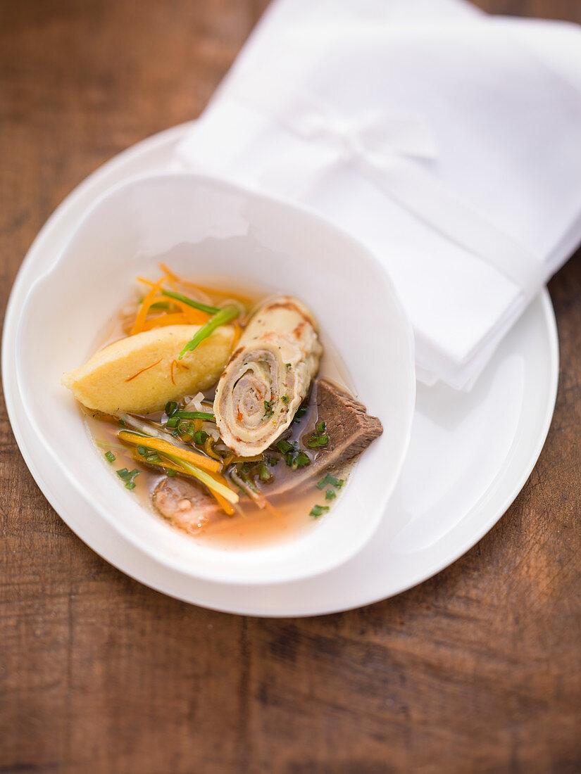 Landshut wedding soup with bread strudel and semolina dumplings