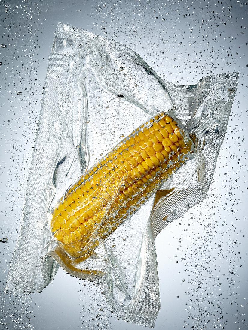 A corn cob in a sous vide bag