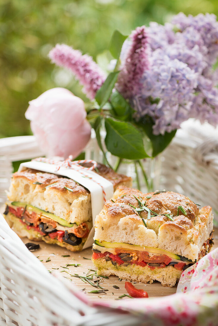 Stuffed focaccia with courgette, tomatoes and olives for summer picnic