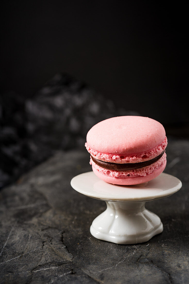 A raspberries macaroon with a chocolate filling