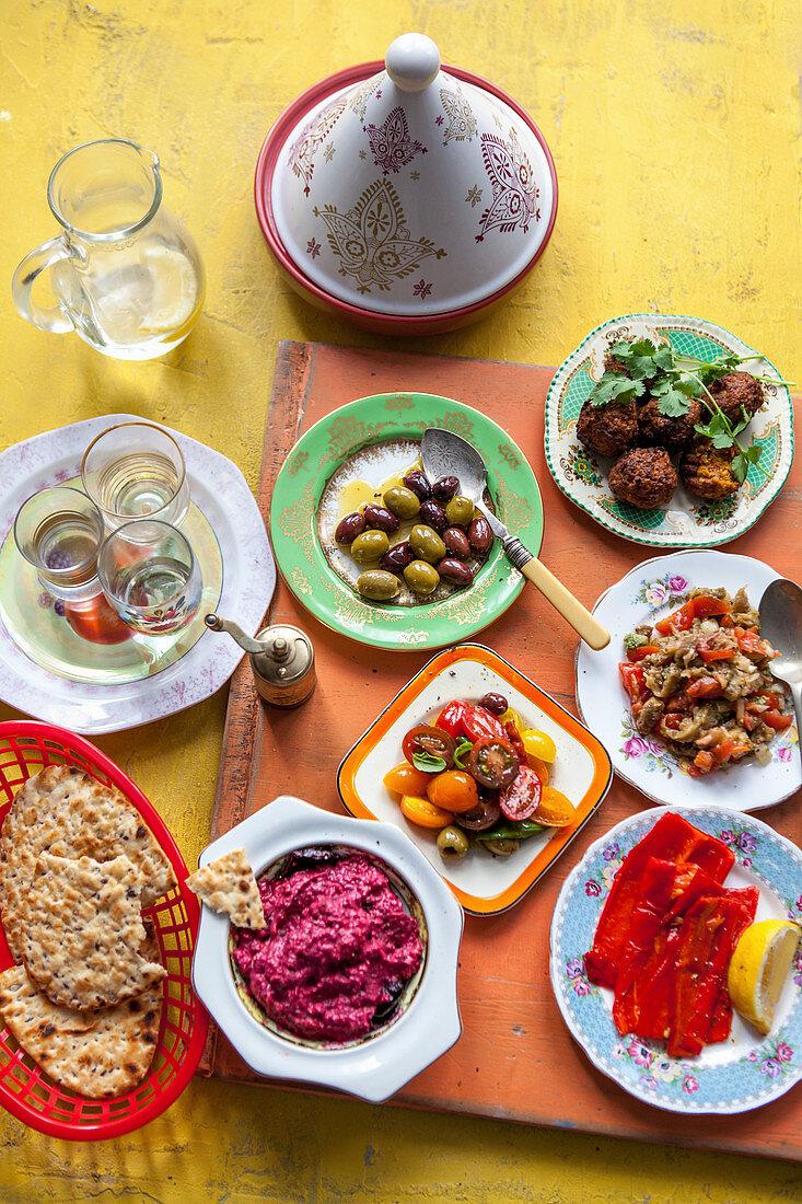 Mutabal, olives, roast peppers, tomate salad, beetroot hummus and flat bread