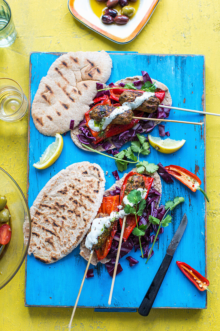 Pitta bread with roasted peppers, köfte and lemons
