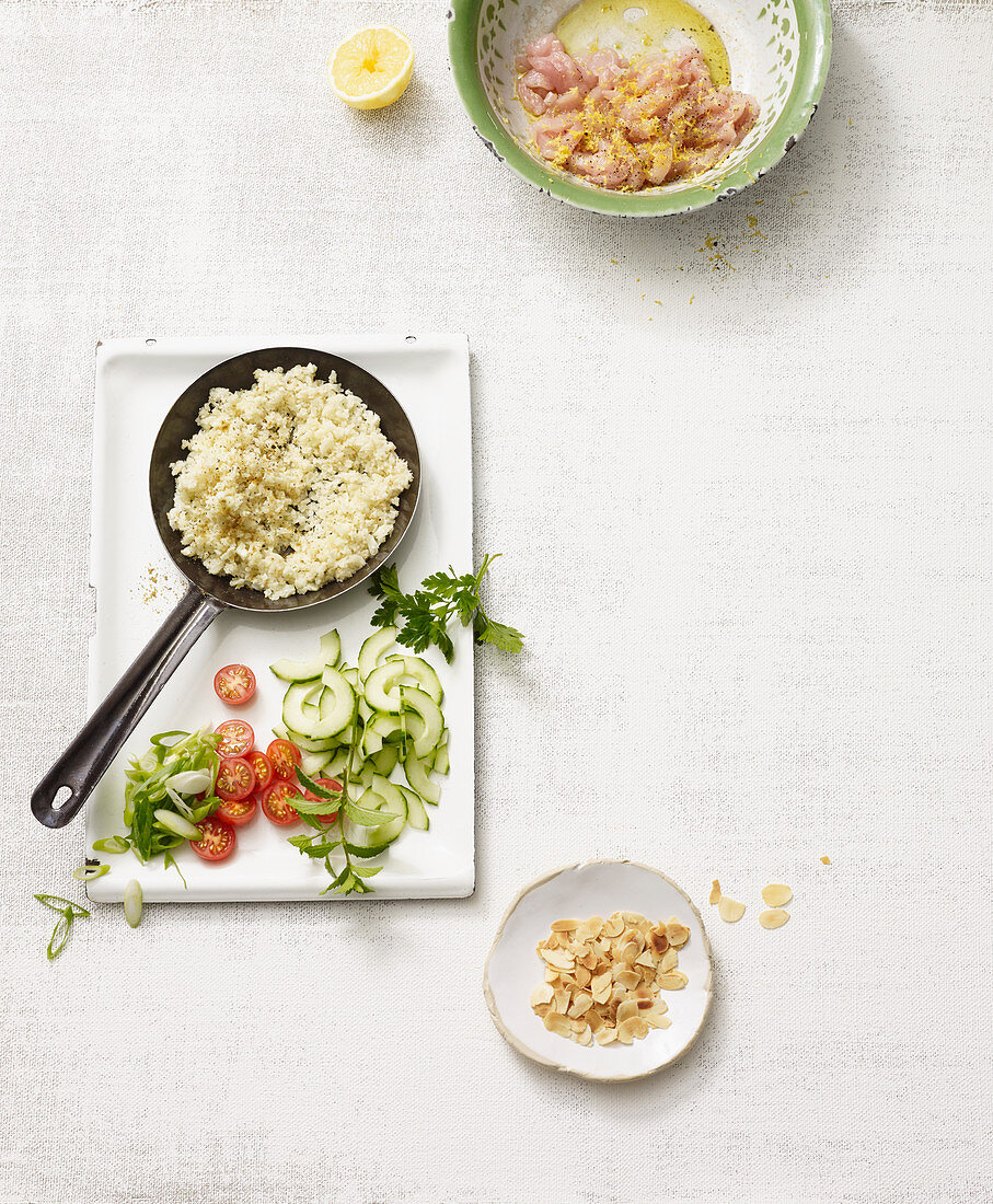 Ingredients for tabbouleh made from cauliflower with cucumber and chicken breast (no carb)