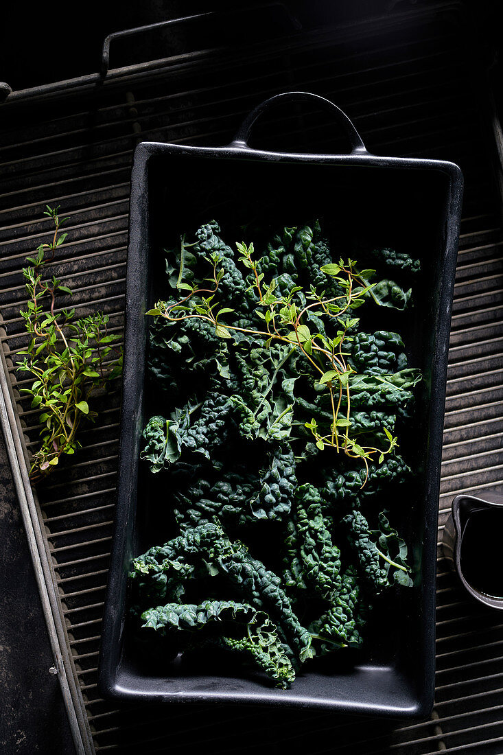 Cavalo Nero in oven dish with thyme and olive oil