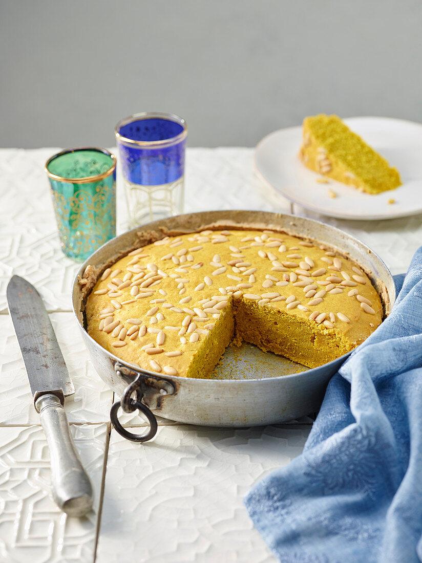 Durum wheat semolina cake with turmeric, tahini and pine nuts