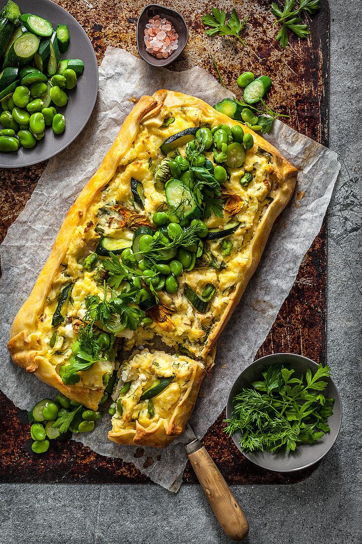 Broad bean and zucchini tart