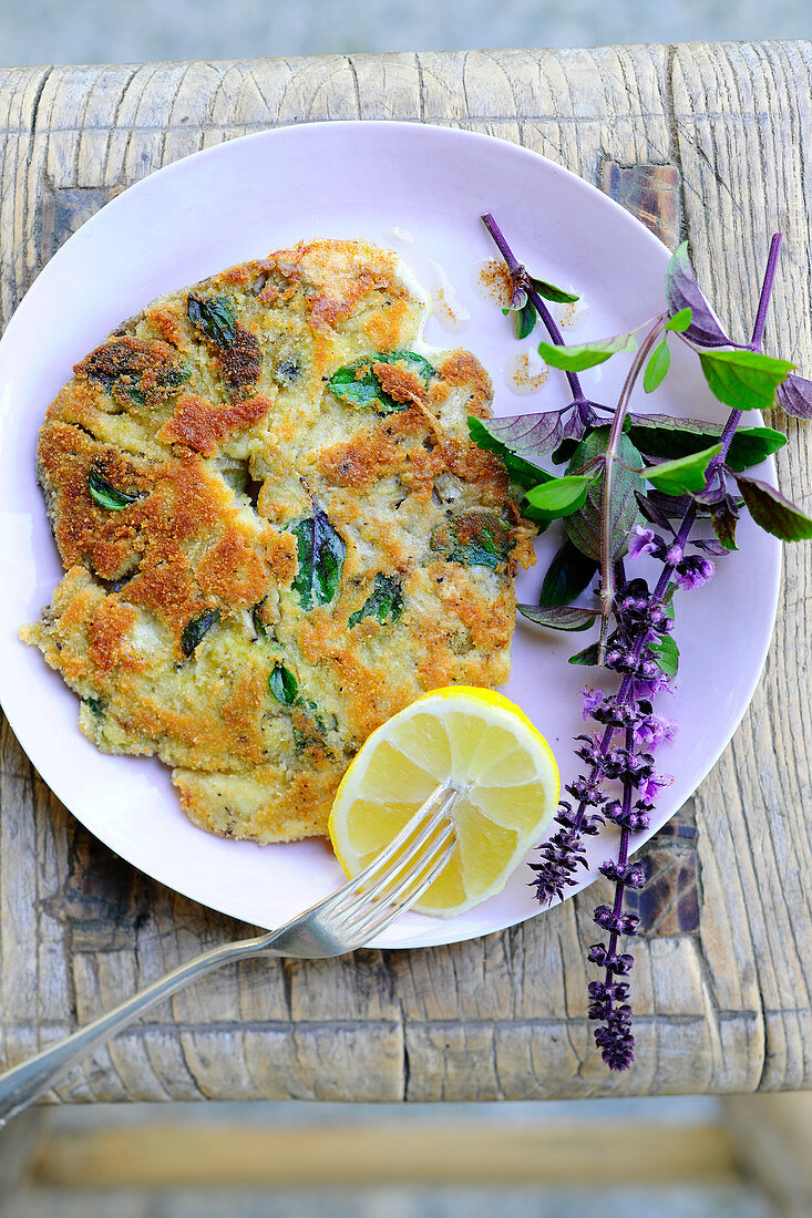 A breaded parasol mushroom escalope with red basil