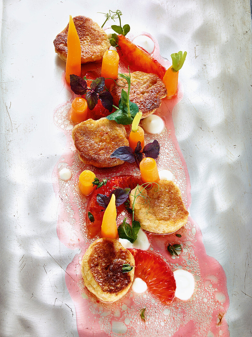Spelt pancakes with aniseed carrots and blood orange vinaigrette