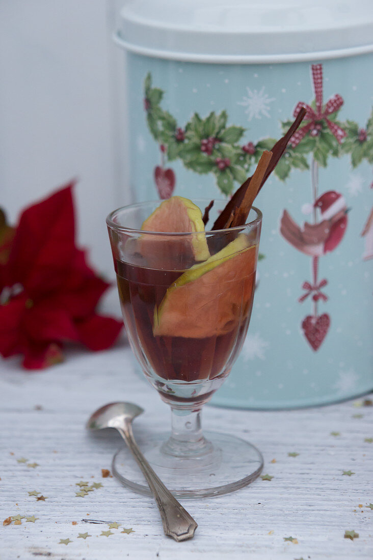 Mulled wine in front of a tin