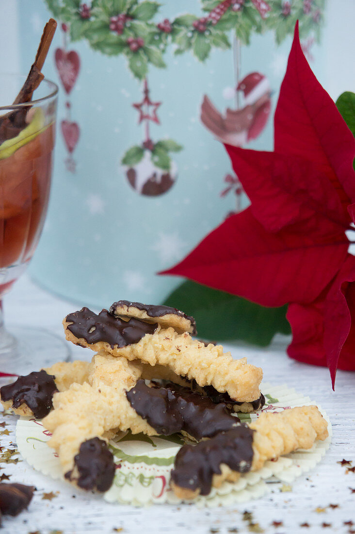Piped biscuits, mulled wine, a tin and a poinsettia