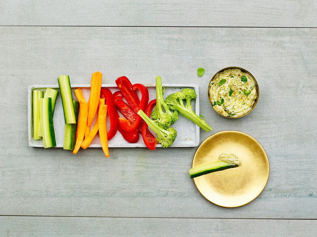Vegetable sticks with a pesto dip