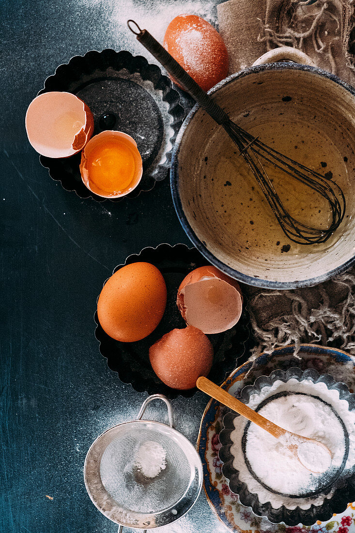 A still life with eggs and flour (top view)