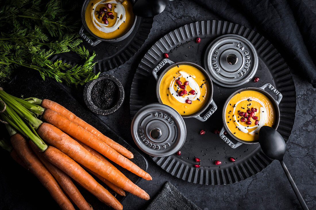 Carrot soup with pomegranate seeds in cocotte ramekins (Morocco)