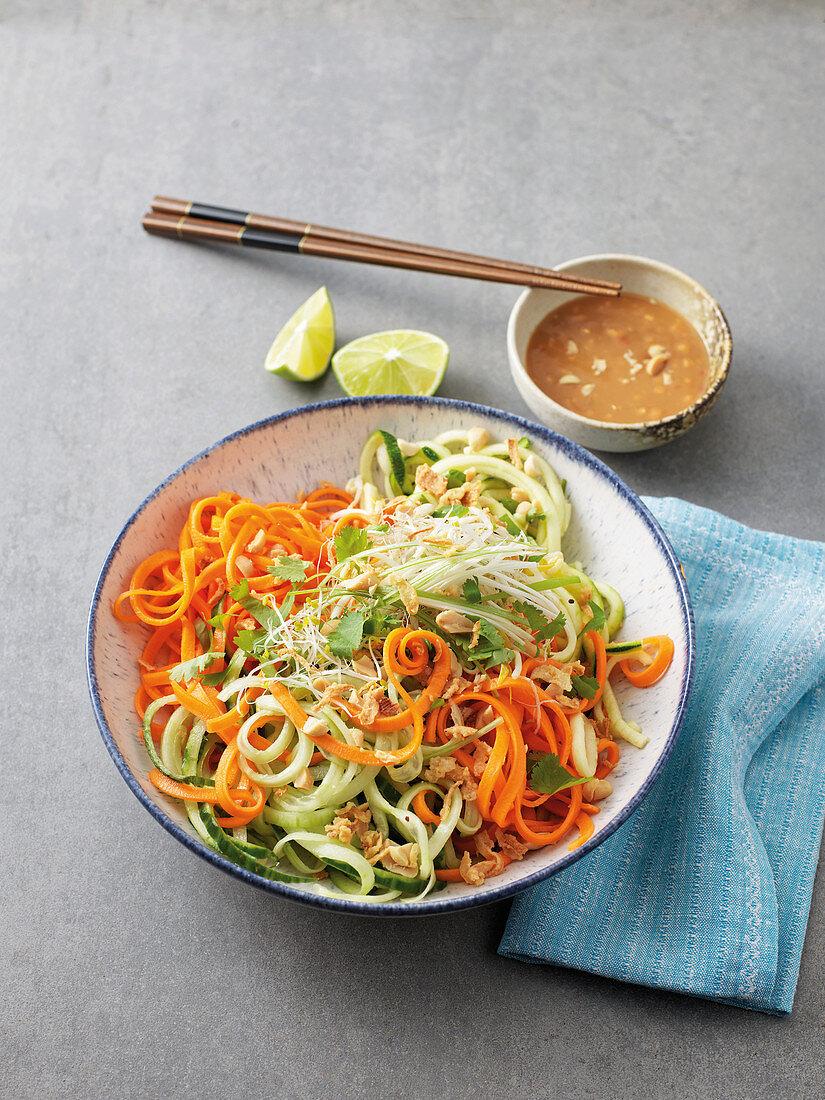 Vegan summer vegetable spiral bowl with peanut sauce