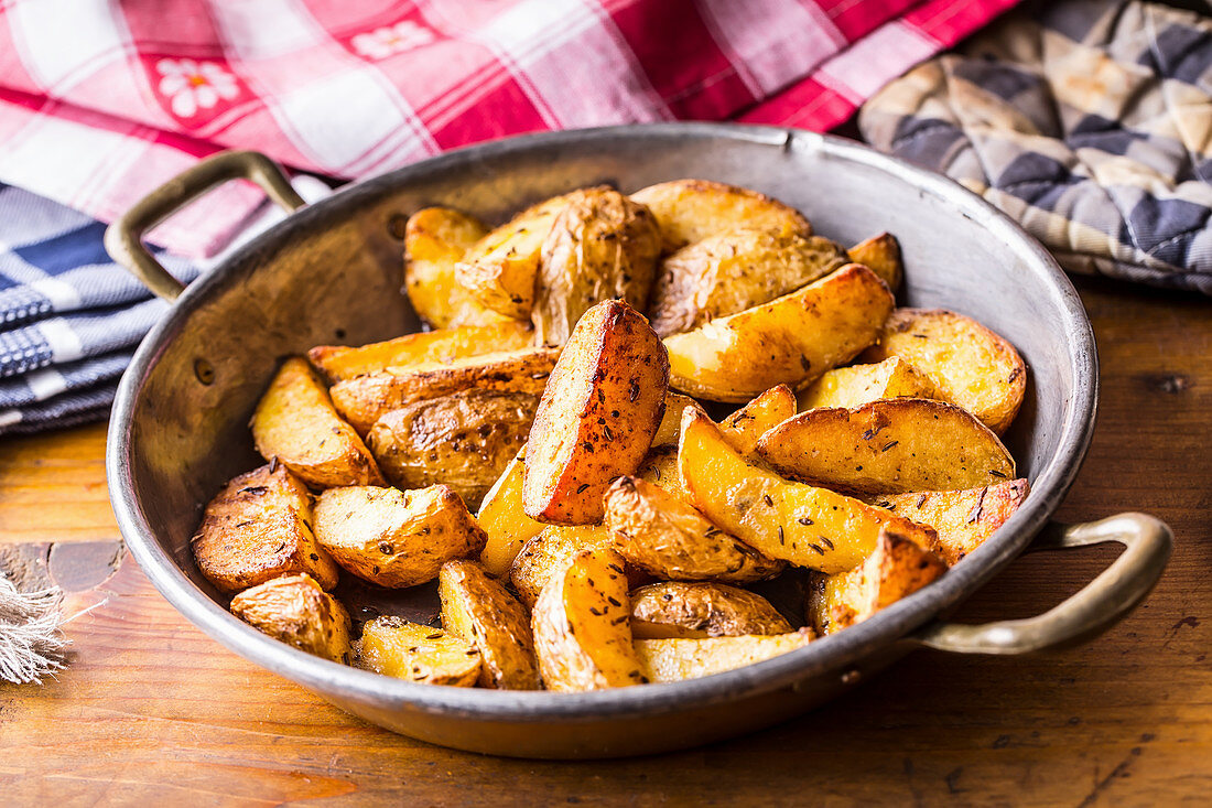 Roasted potato wedges with caraway seeds