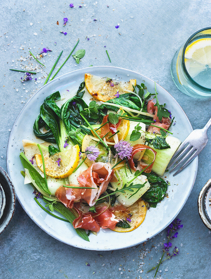 Warm bok choy with prosciutto and a lemon and ginger dressing