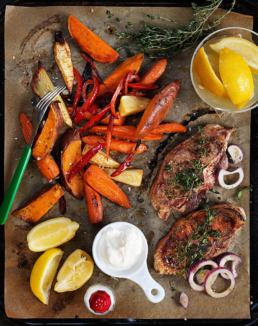 Thyme pork chops with peppers, carrots and sweet potatoes