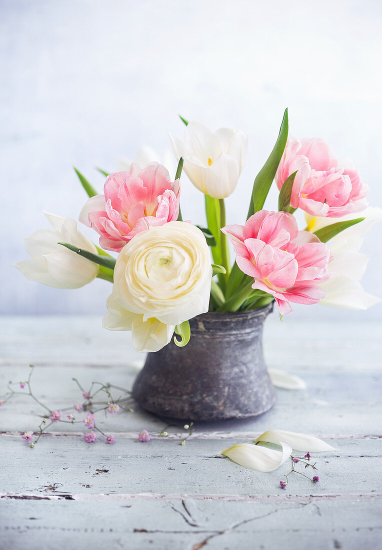 Posy of ranunculus and tulips in vase