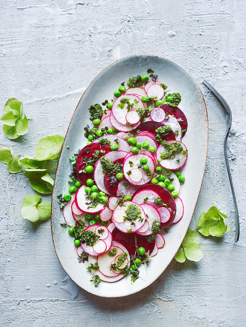 Beetroot salad with radishes, peas and pesto