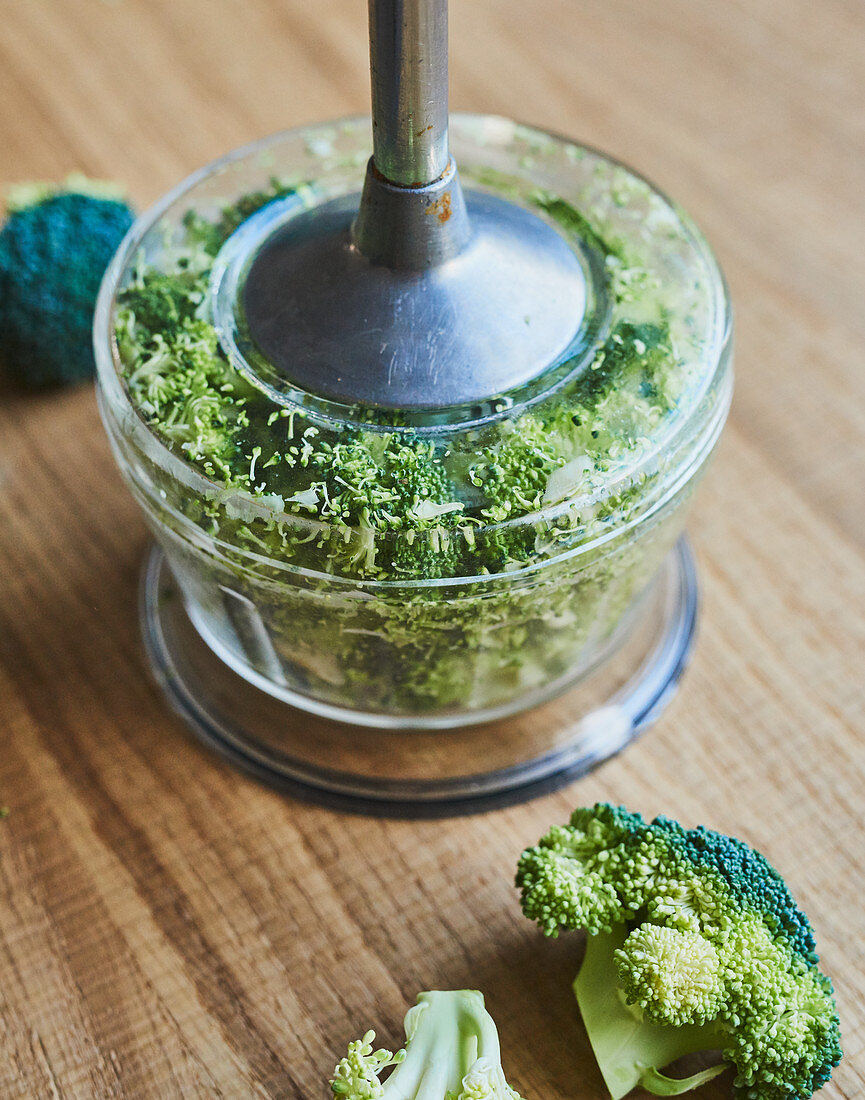 Broccoli being pureed in a hand blender