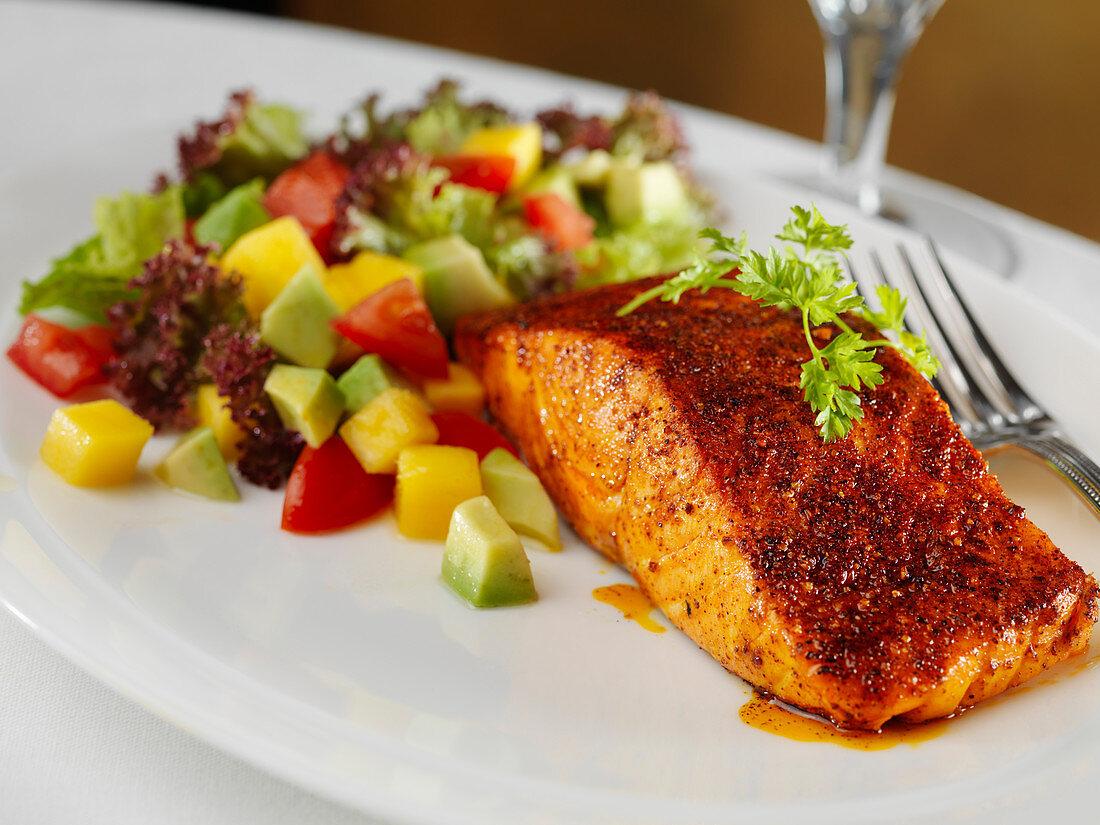 Roasted salmon with avocado and tomato salad