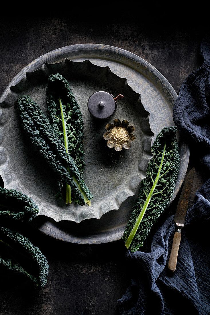 Still life of cavolo nero and sesame seeds
