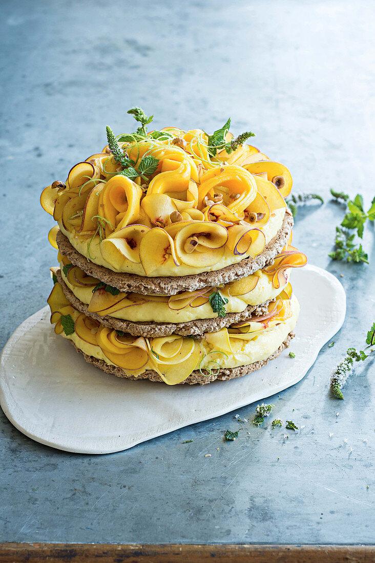 Hazelnut macaroon cake with lime cream, peach and mango