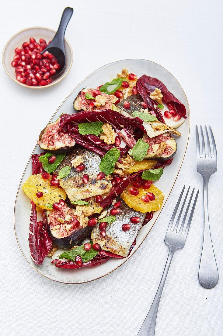 Radicchio salad with fish, oranges and pomegranate seeds