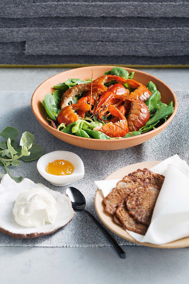 Yabby tails with buckwheat pikelets and creme fraiche