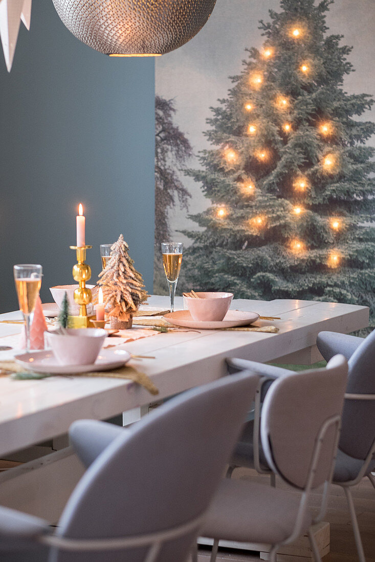 Festively set dining table and wall hanging decorated with fairy lights