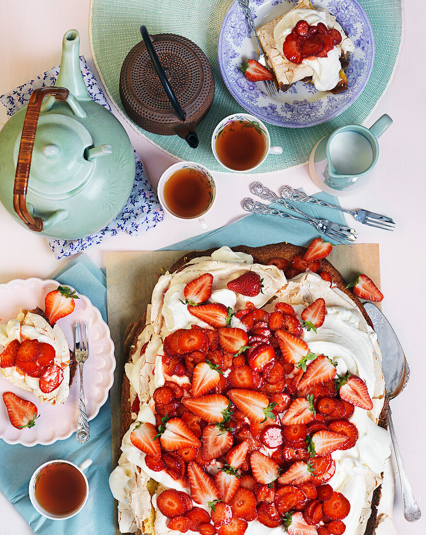 Meringue cake with cream and fresh strawberries for teatime