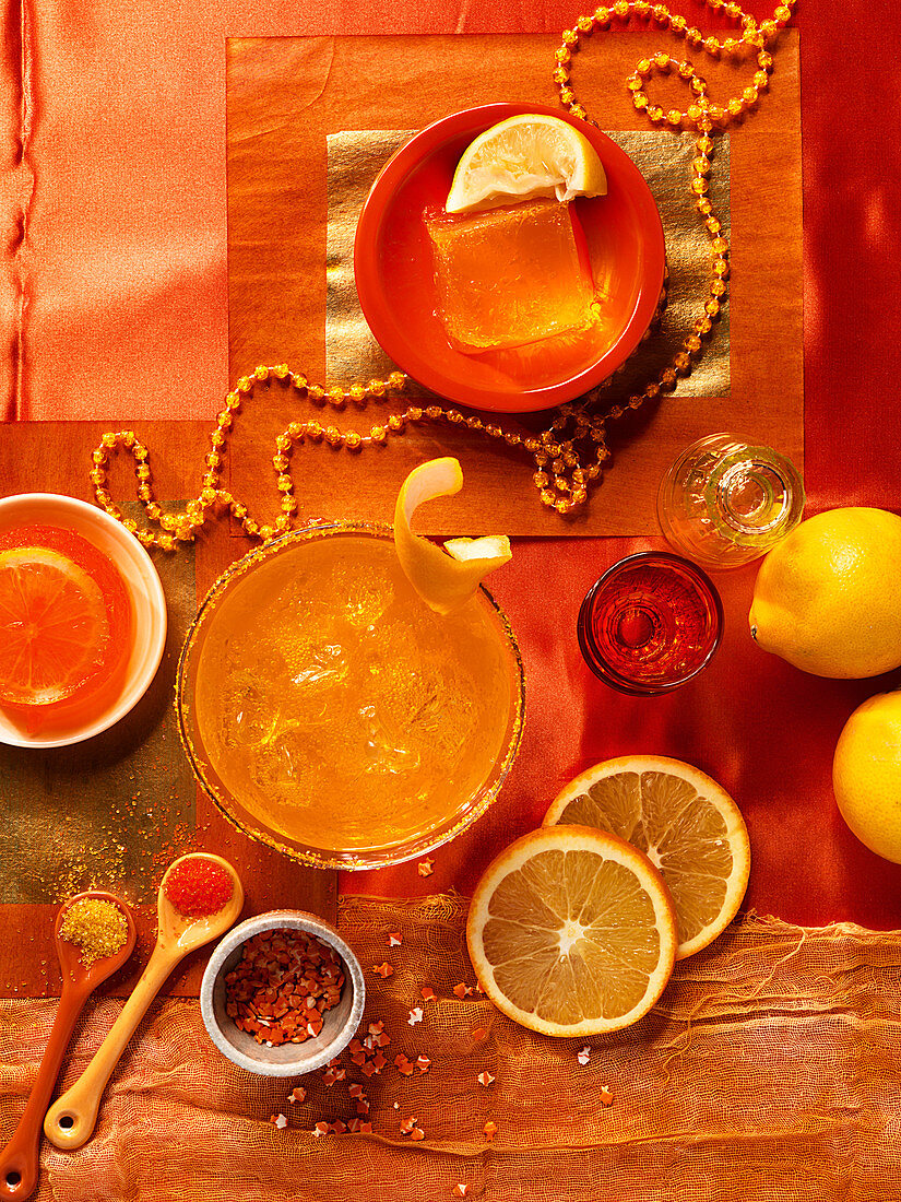 Orange jelly and orange juice on an orange background
