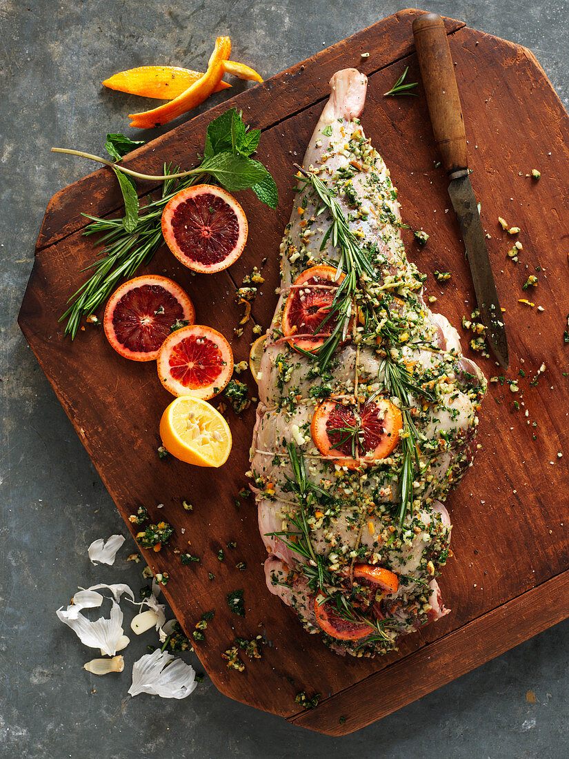 Leg of lamb with herbs, spices and blood orange slices (ready to roast)
