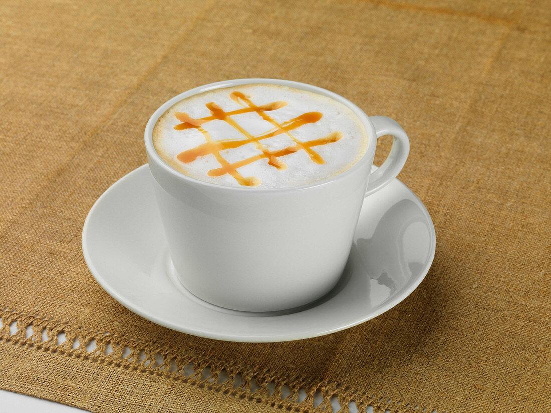Espresso macchiato with a caramel lattice