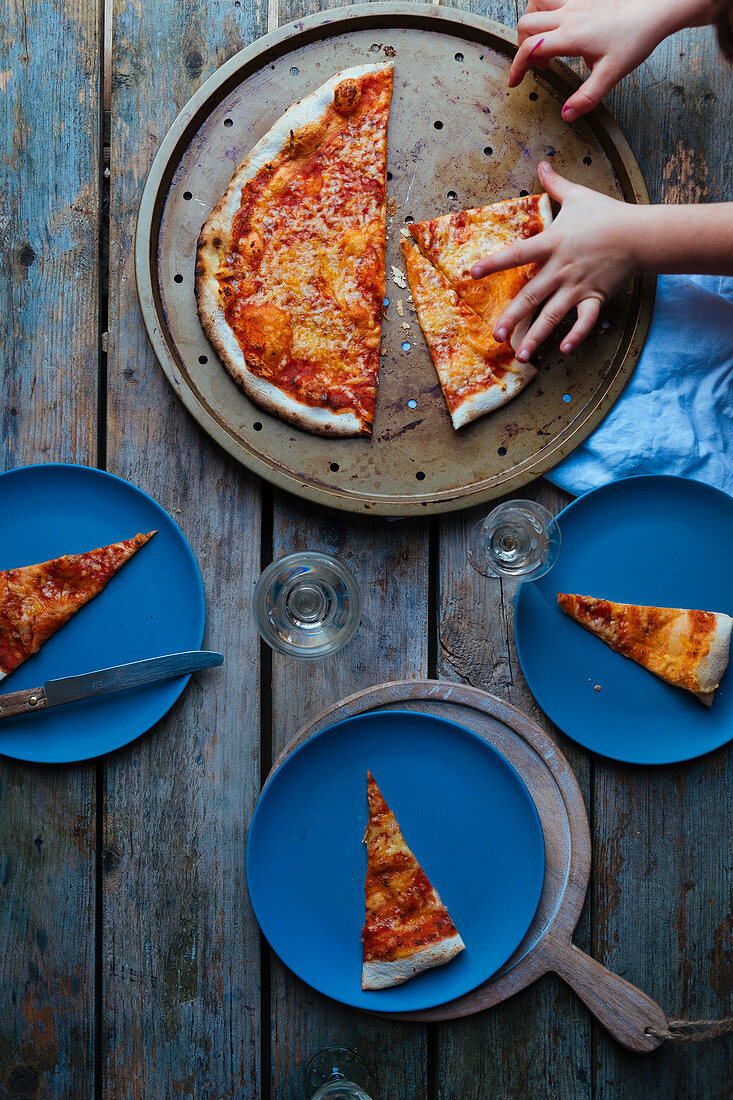 Pizza and children's hands