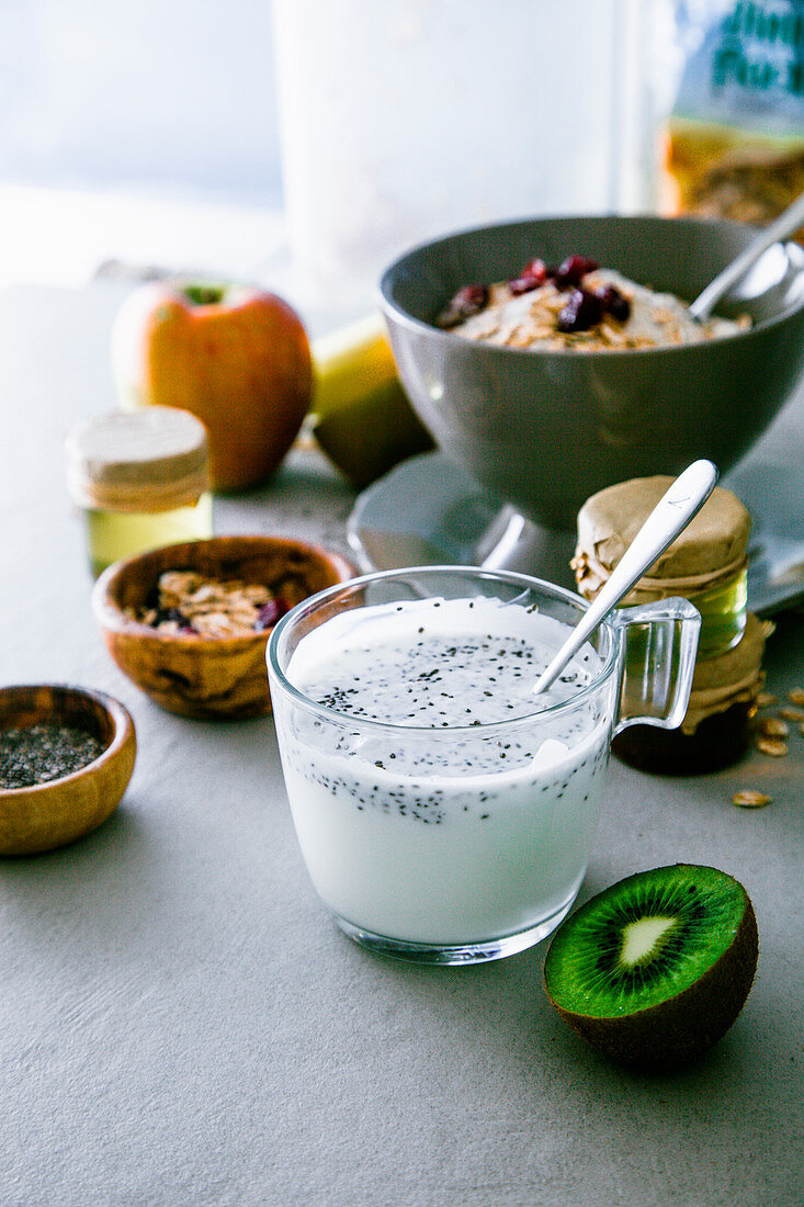Healthy breakfast variety: Cereals with fruit and Yogurt with seeds