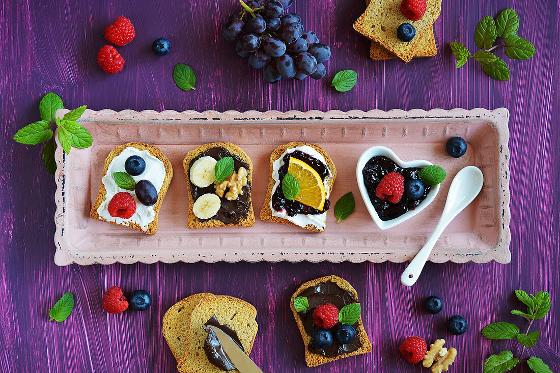 Sweet canapes made of rusk with fresh fruits and mint