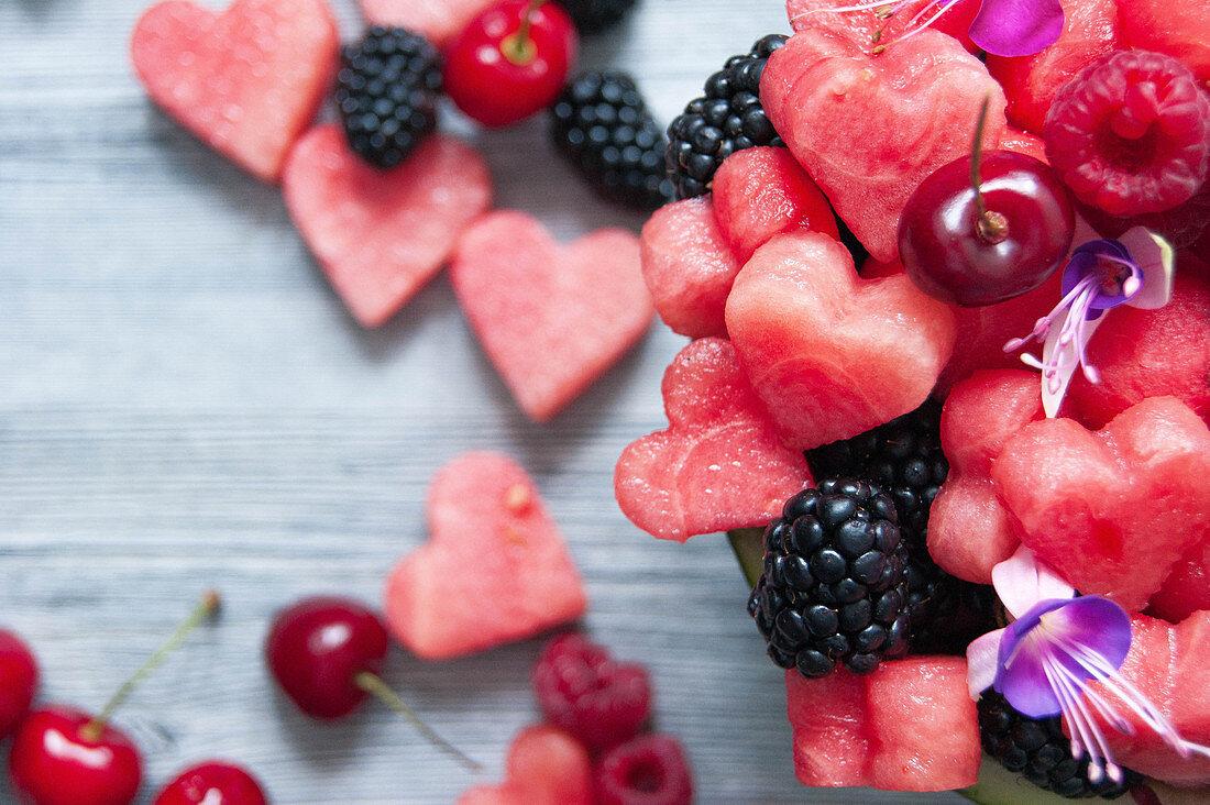 Watermelon hearts, cherries, raspberries and blackberries