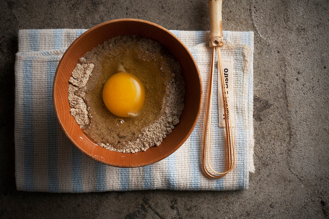 Grain powder with a open egg for making a face mask