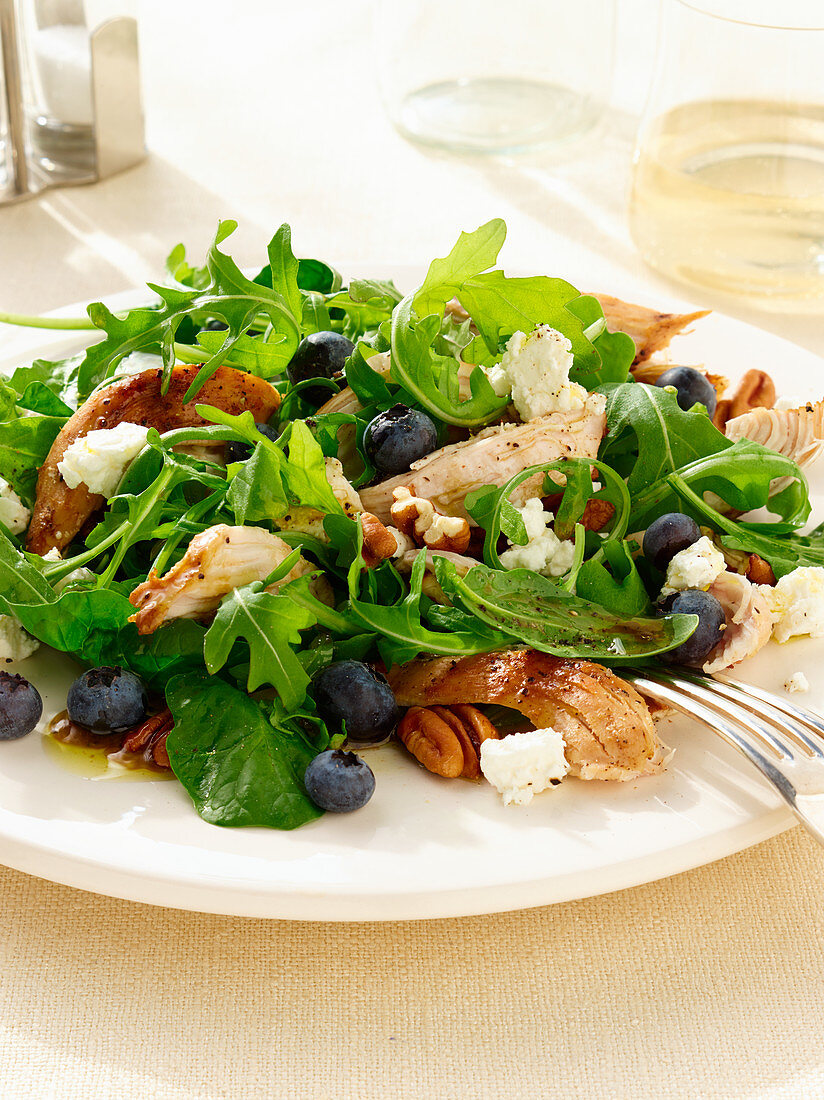 Blueberry and chicken salad with rocket