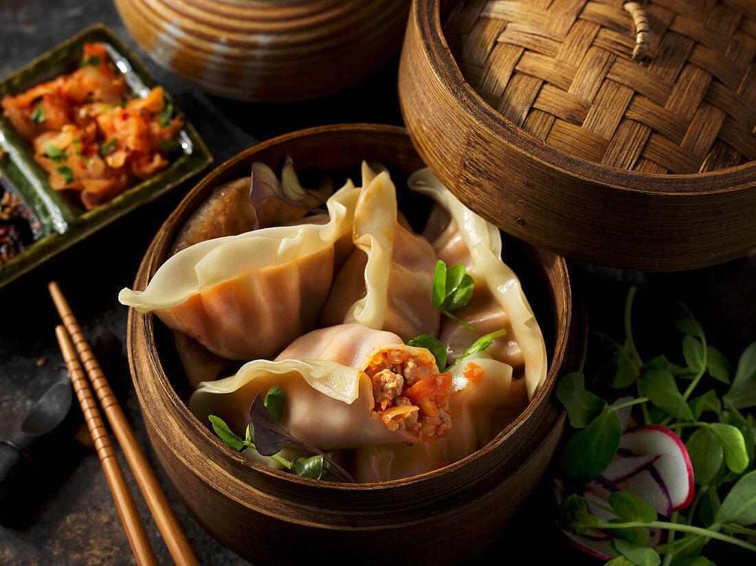 Asian dumplings in a bamboo basket