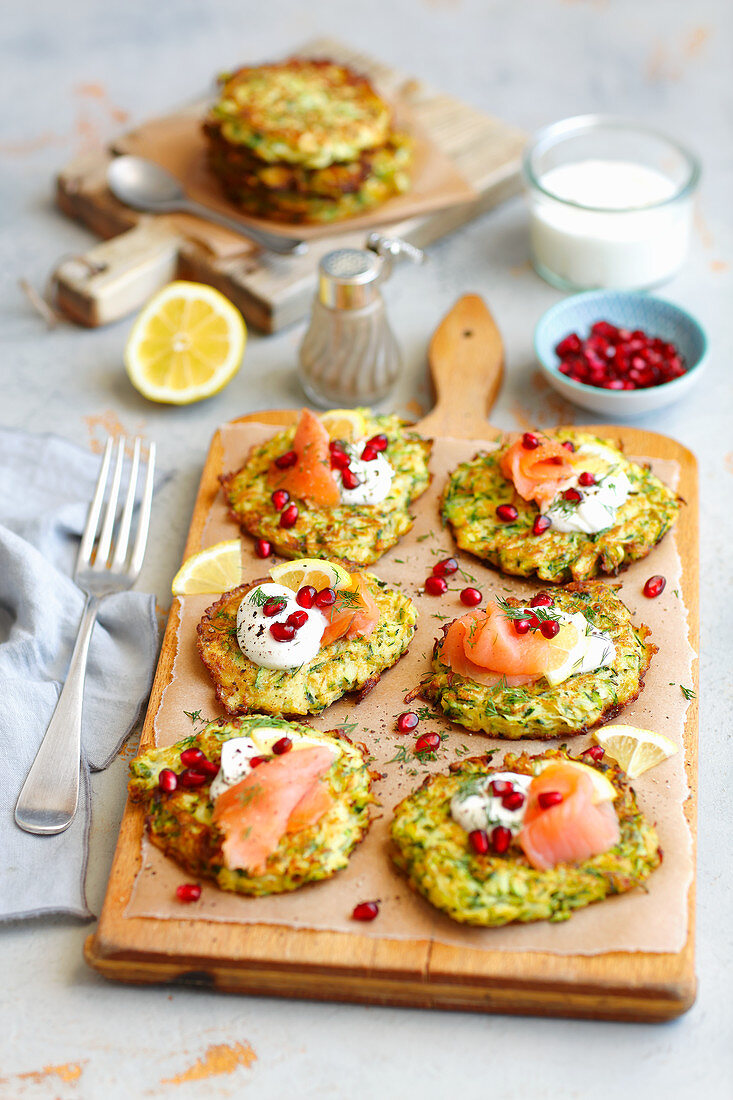 Courgette fritters with smoked salmon and cream and pomegranate