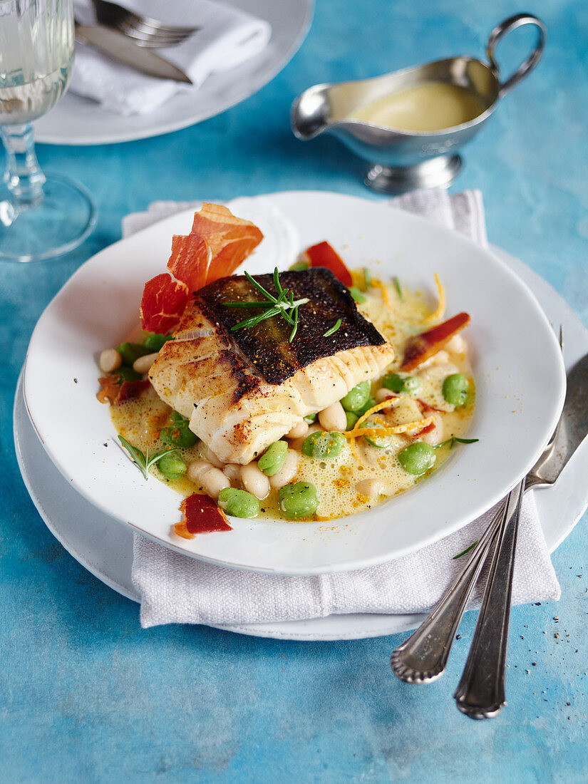 Cod on green and white beans in orange sauce