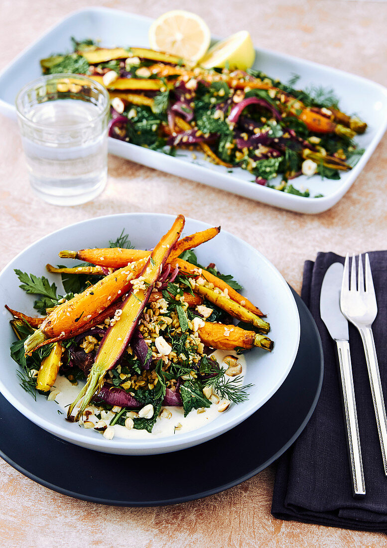 Roasted heirloom carrots, cooked freekeh grain, roasted red onions, kale, parsley, dill, maple syrup and orange dressing with zatar