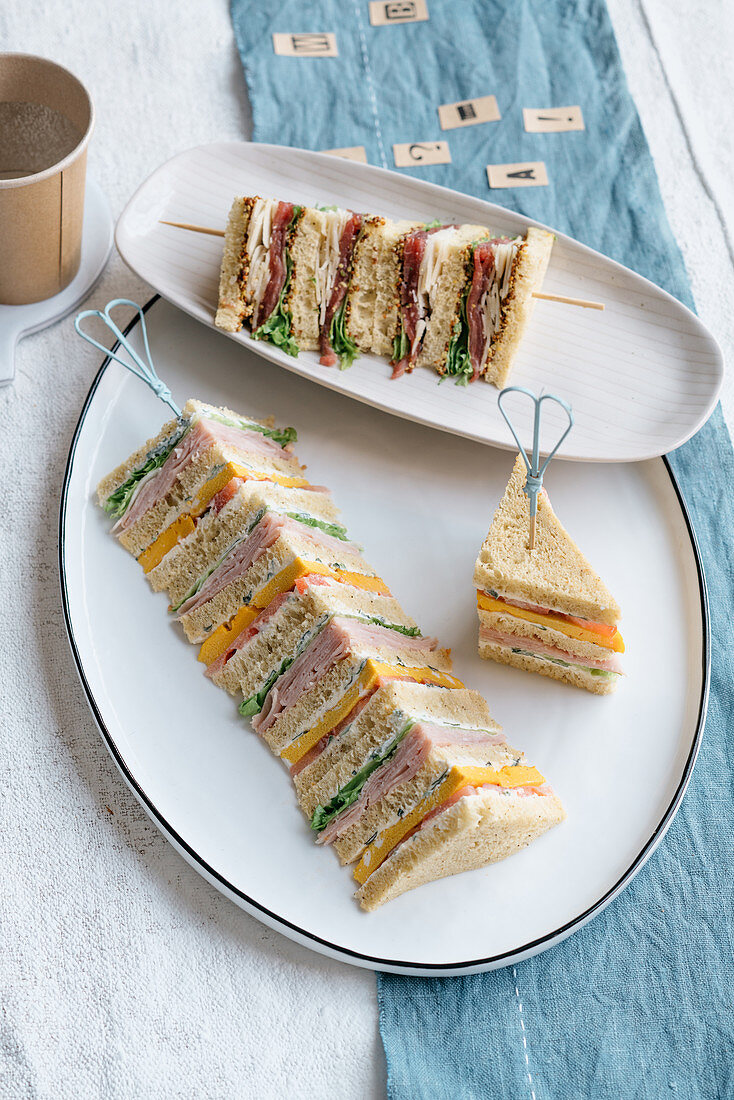 Club sandwiches with beef carpaccio, and with omelette and ham